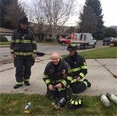 Firemen doing a bottle change