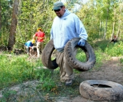 Worker Carrying Tires