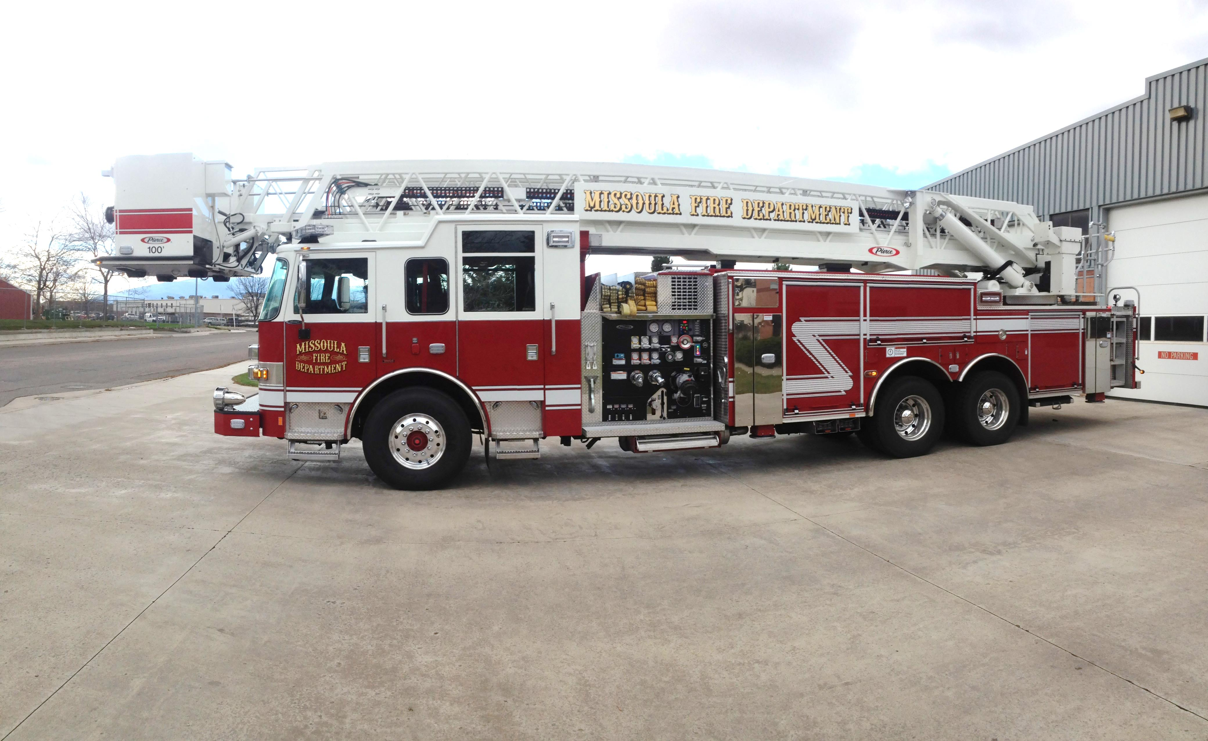 MFD red ladder truck staged outside Station 4.