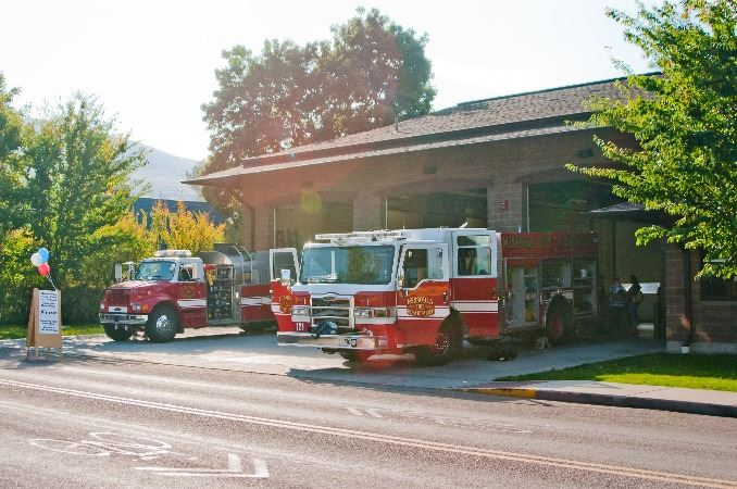 Fire Engines parked in front of a station