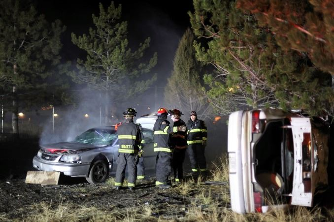 Firefighters at a car crash