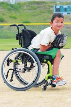 All Abilties sports with a child in a wheelchair